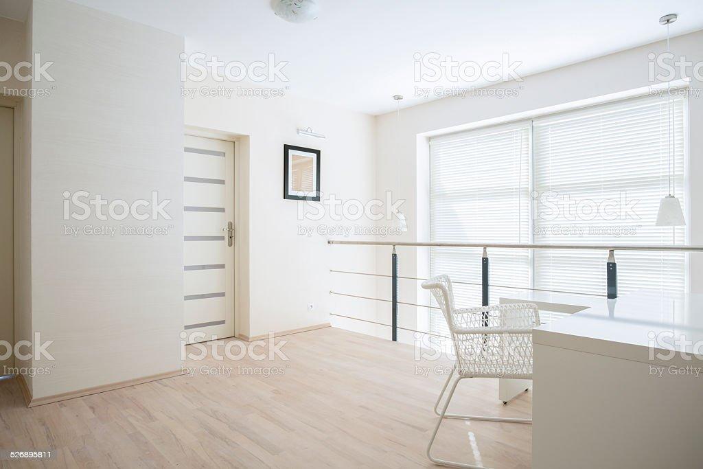 Bright corridor on mezzanine floor stock photo