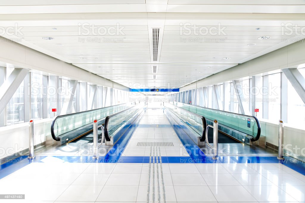 Bright Corridor with Moving Walkways stock photo