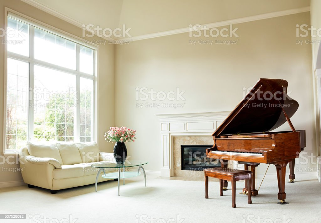 Bright daylight living room with grand piano stock photo
