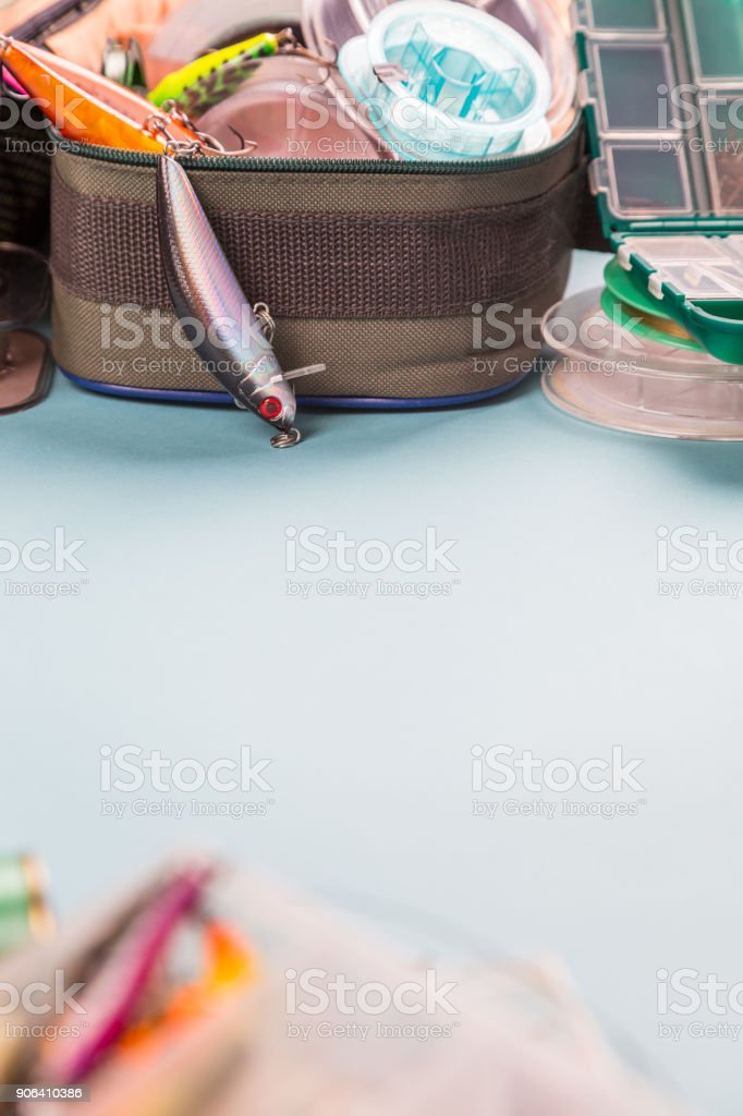 bright different fishing tackles on color paper background. outdoors activity sport and relax stock photo