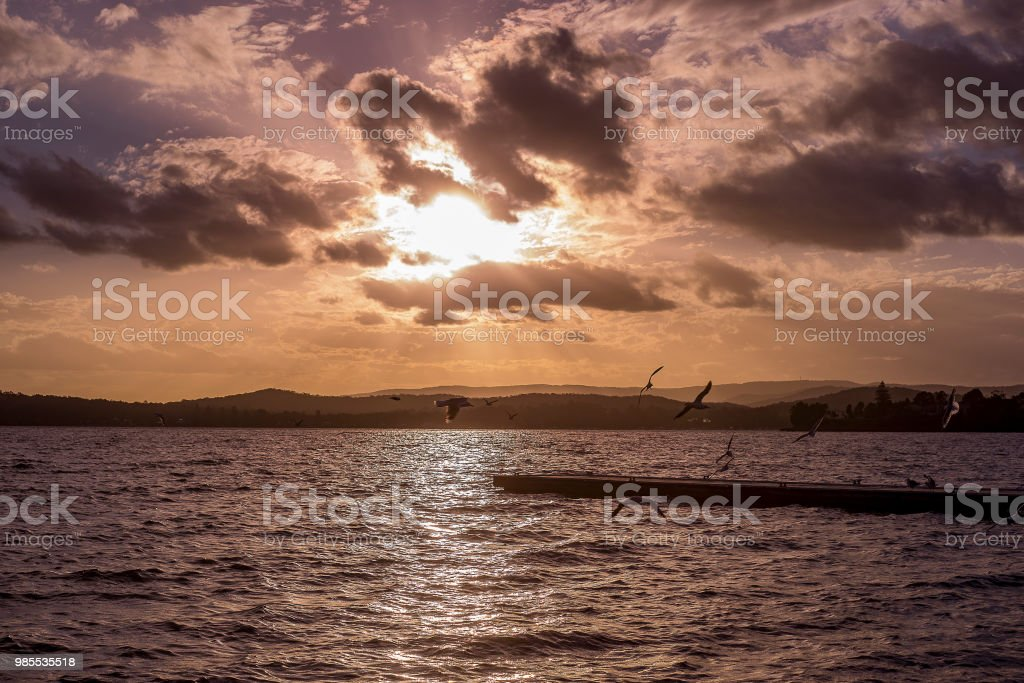 ff90c0418fd38 Bright Dramatic Sunset Sky With Sun Ray Shine From Cloud Silhouette ...