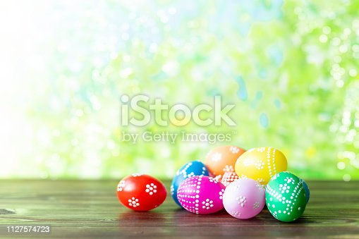 912300146 istock photo bright early colored easter eggs on a sunny spring background 1127574723