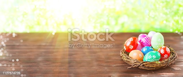 912300146 istock photo bright early colored easter eggs on a sunny spring background 1127574725