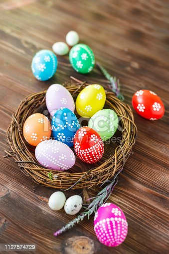 912300146 istock photo bright early colored easter eggs wooden background 1127574729
