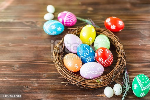 912300146 istock photo bright early colored easter eggs wooden background 1127574739