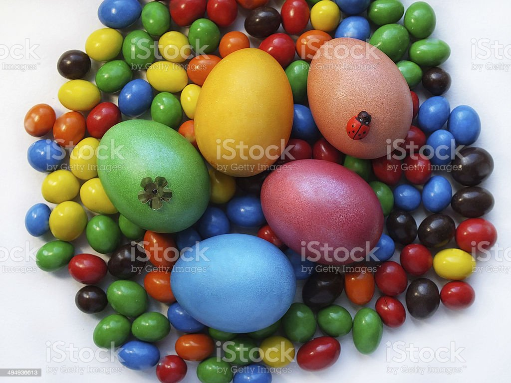 Bright Easter eggs and candies royalty-free stock photo