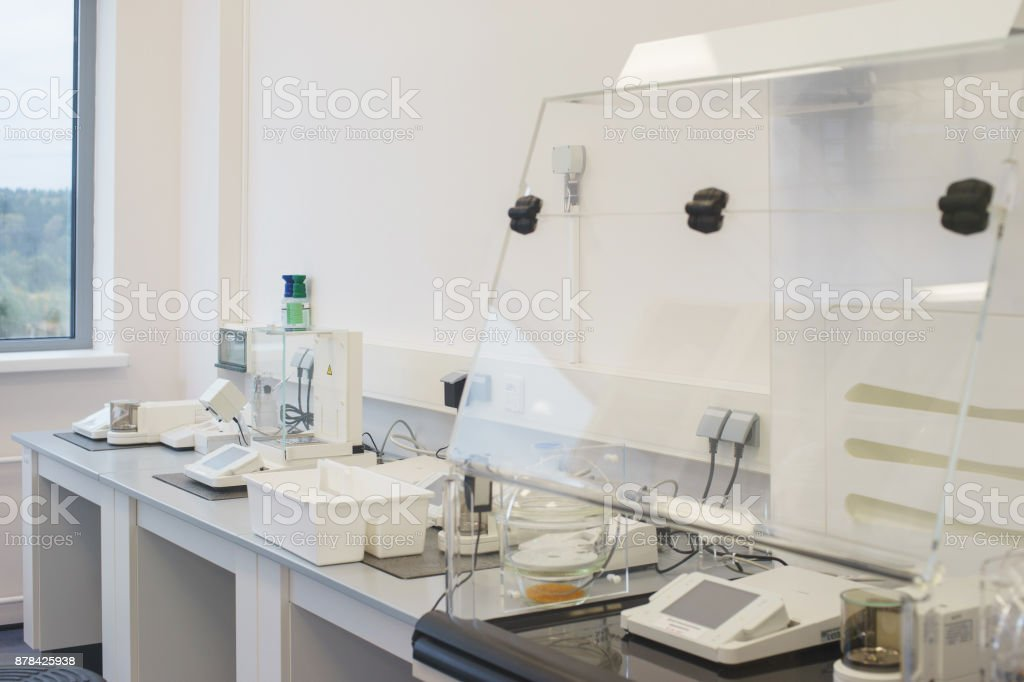 Bright empty office in a scientific medical laboratory equipped with modern measuring equipment and special devices. stock photo