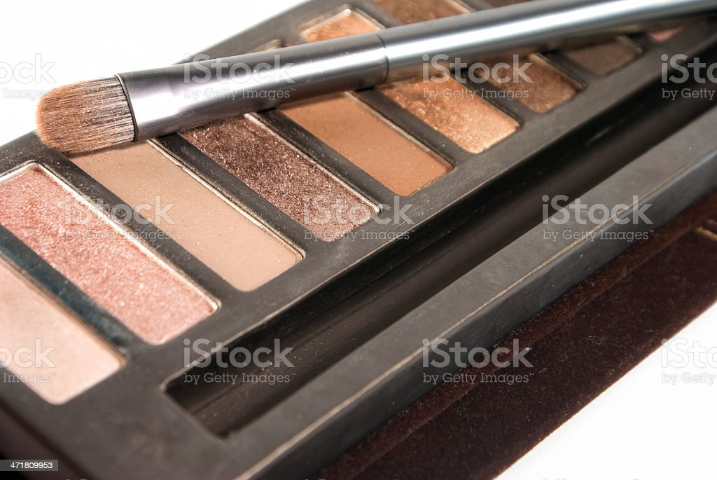 Bright eye shadows and brush close-up royalty-free stock photo