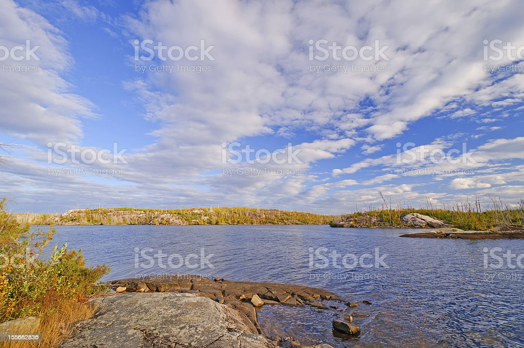 Bright fall skies in the North Woods royalty-free stock photo