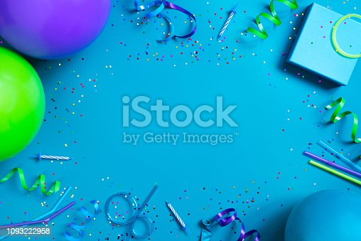 istock Bright festive blue background with birthday party accessories 1093222958