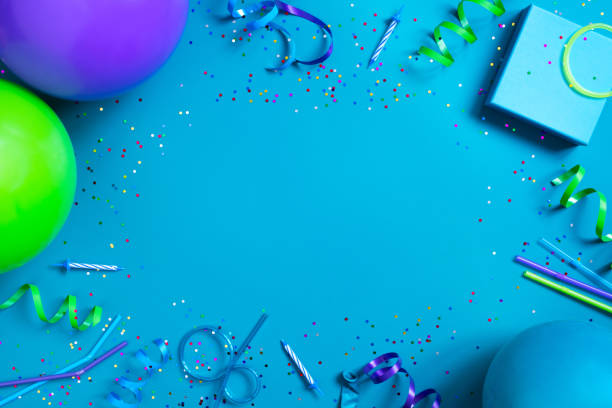 Bright festive blue background with birthday party accessories Bright festive blue background with birthday party accessories, copy space birthday background stock pictures, royalty-free photos & images