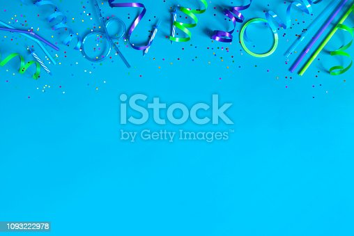 1093222958 istock photo Bright festive blue background with party accessories 1093222978