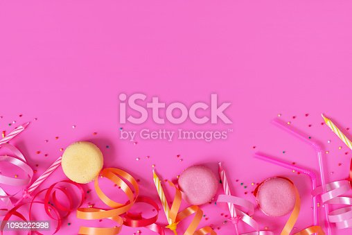 1093222958 istock photo Bright festive pink background with birthday party accessories 1093222998