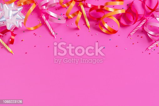 1093222958 istock photo Bright festive pink background with birthday party accessories 1093223126