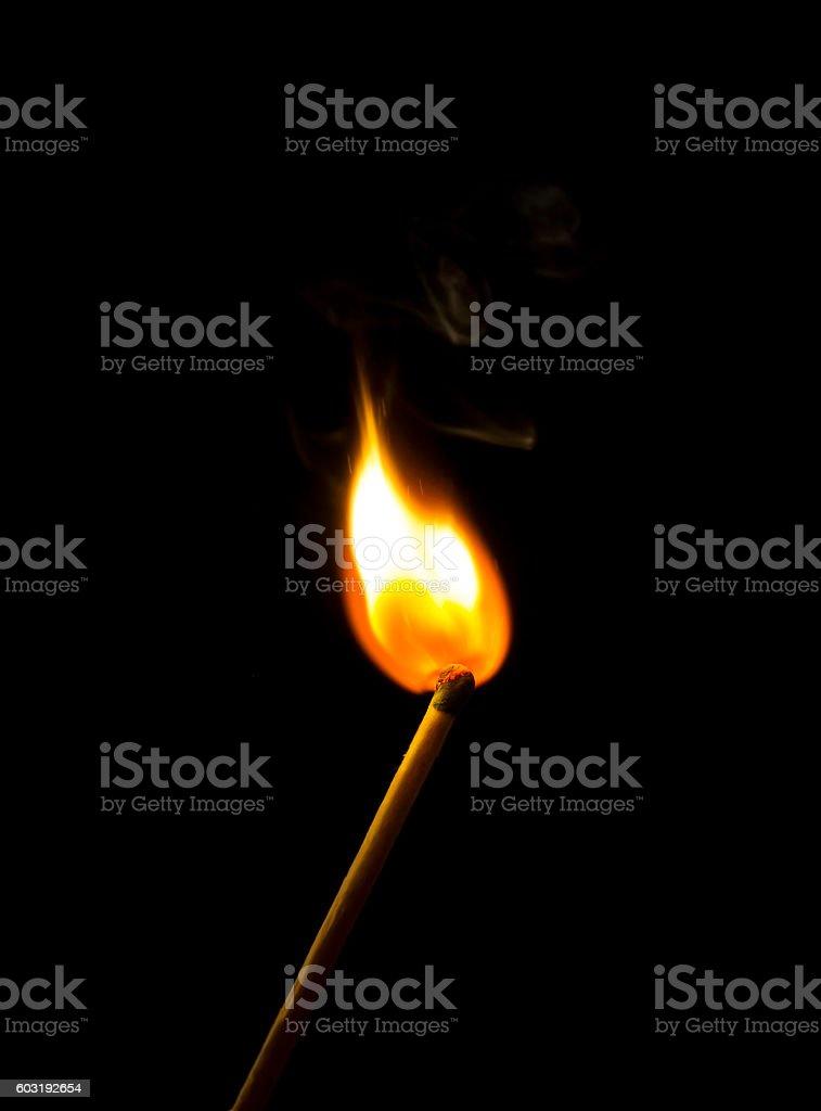 Bright flash sulfur match on a dark background stock photo