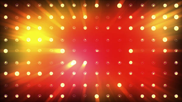 bright floods of orange light flash very brightly. - stage light stock pictures, royalty-free photos & images