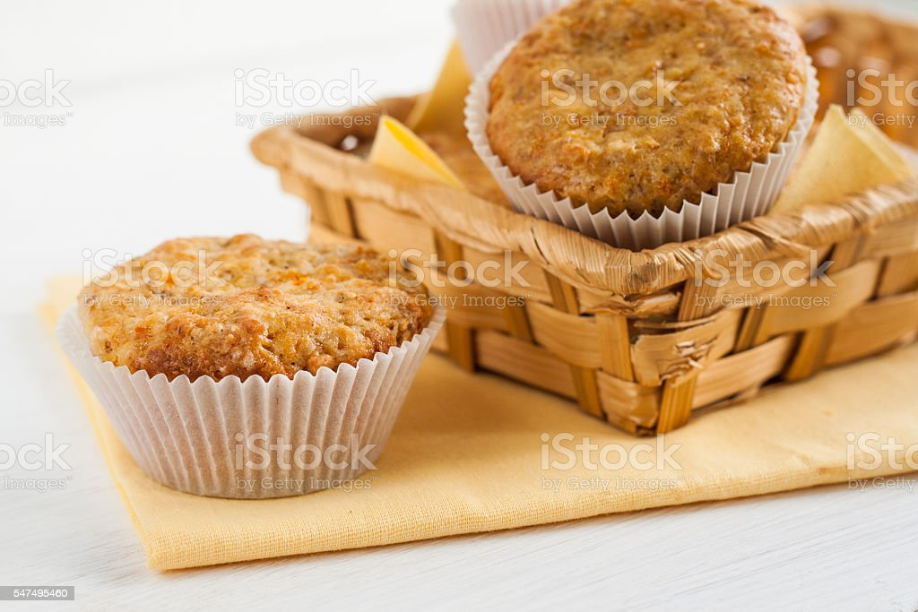 bright fragrant pumpkin cup cakes, muffins in a basket stock photo