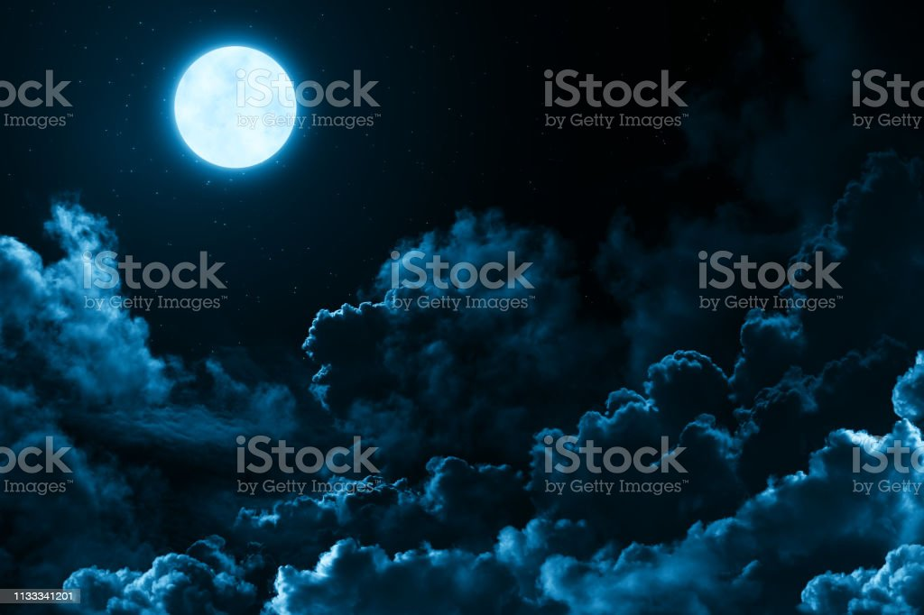Bright full moon in the mystical midnight sky with stars surrounded...