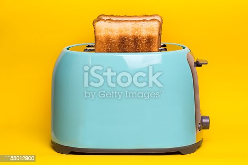 istock bright, fun breakfast. cyan color toaster on a wooden background