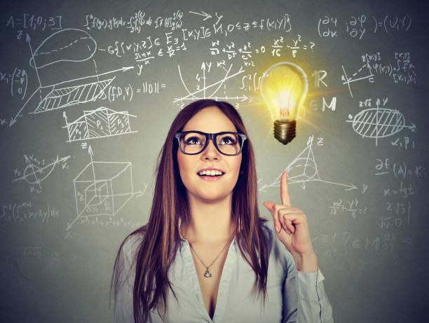 bright girl having great idea - formula 1 стоковые фото и изображения