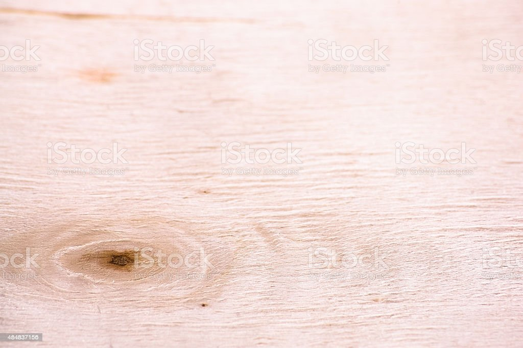 Bright gnarled wooden plank useful as background or texture. stock photo
