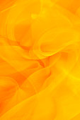 Golden light swirls in a bright abstract background.