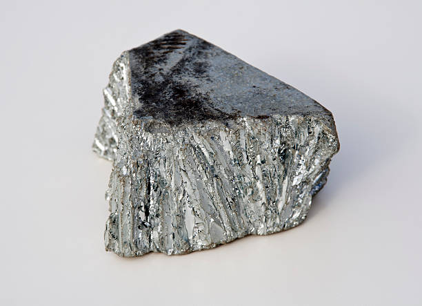 bright gray zinc mine nugget on white background - nickel stock photos and pictures