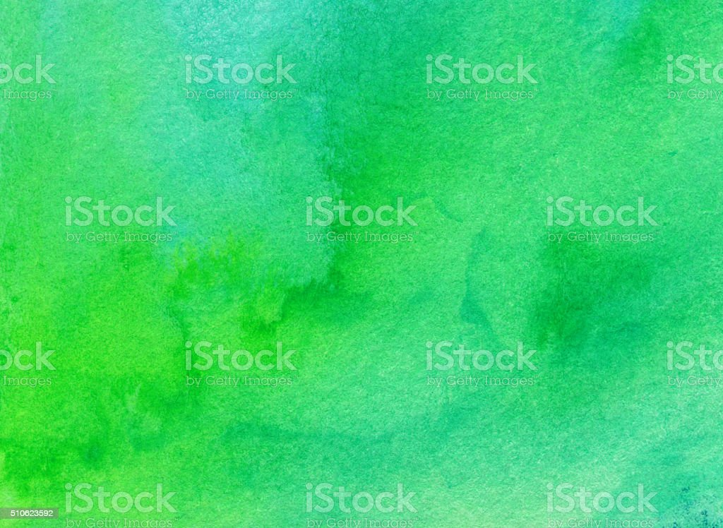 Bright green and blue hand painted background with mottled colors stock photo