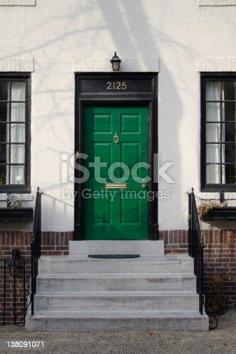 Green front door and steps.  Philadelphia, PA.