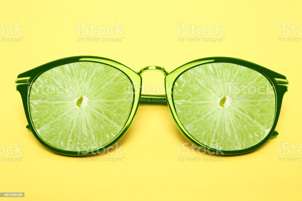 Bright green sunglasses with lime stock photo