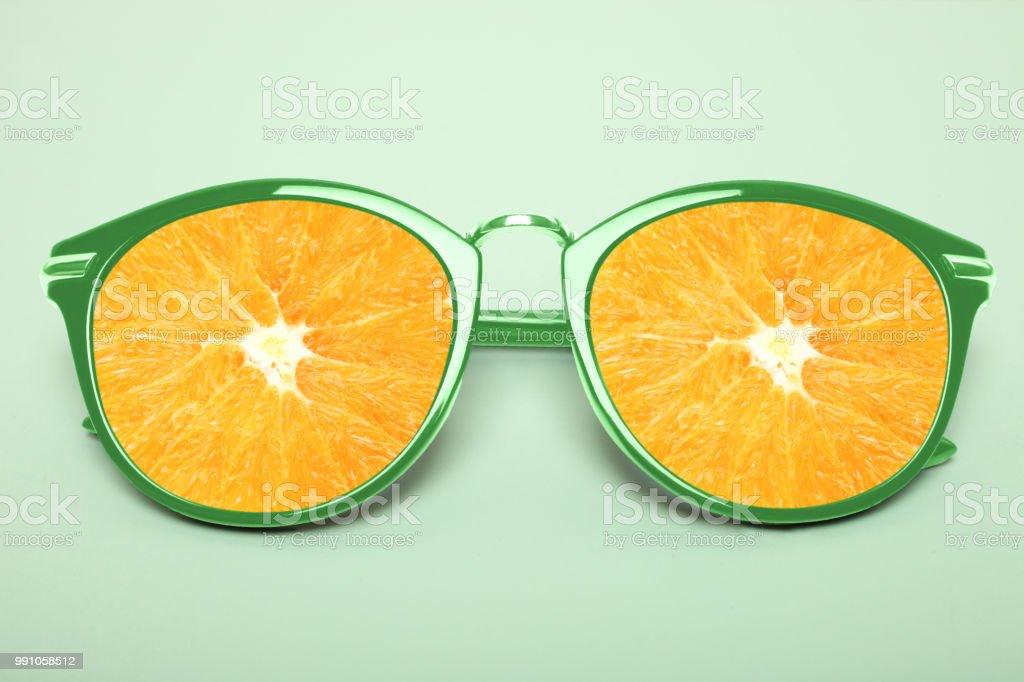 Bright green sunglasses with orange stock photo