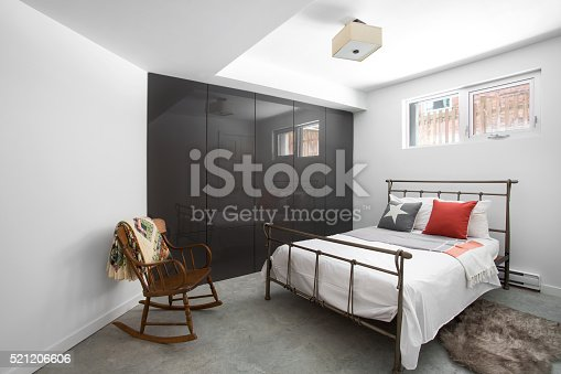 istock Bright Guest bedroom with rocking chair. 521206606