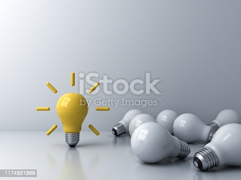 istock Bright idea bulb standing out from the crowd of dim unlit lying white bulbs creative idea concept 1174931869