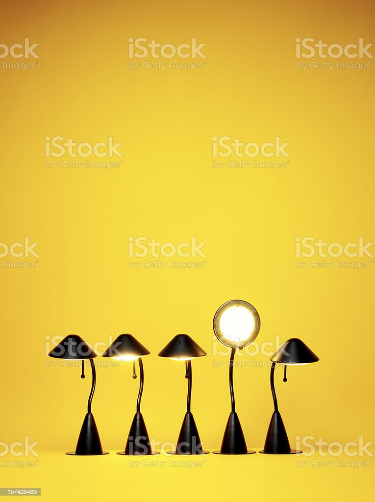 Bright Idea, Five desk lamps against yellow royalty-free stock photo