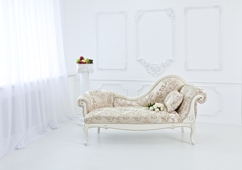 Bright interior of the Renaissance and Baroque with a couch.