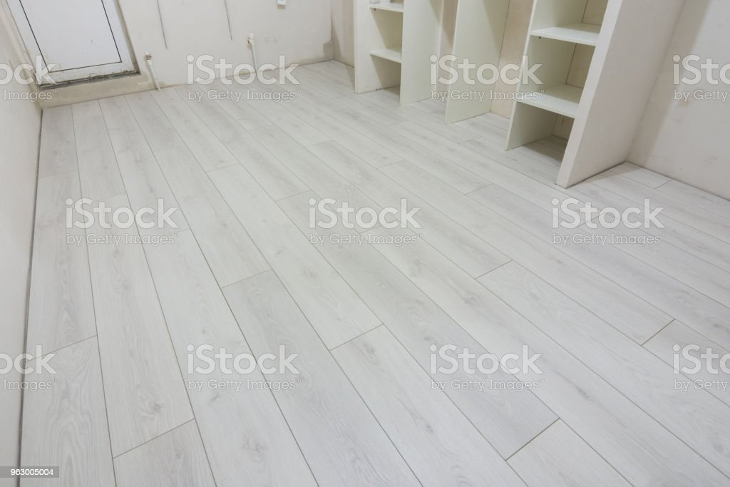 Bright laminate is laid in a renovated residential building stock photo
