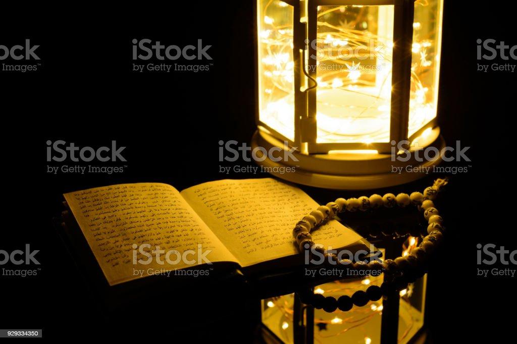 Bright lantern and Holy Book Quran. Ramadan Kareem background stock photo