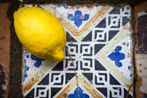 Bright Lemon on Antique Broken Italian Tile (Still Life)