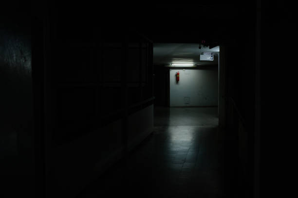 Bright light at the midway of horror corridor stock photo