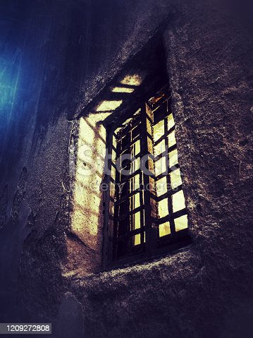 istock bright light comes out of a scary grated window 1209272808