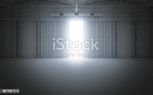 istock Bright light coming through open hangar doors. 3d rendering 997597274