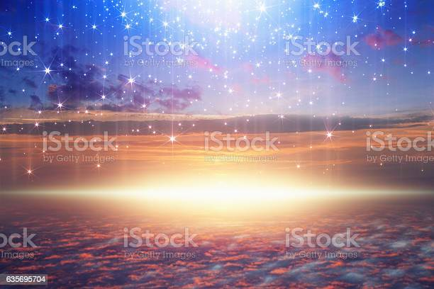 Amazing heavenly background - bright light from heaven, stars fall from skies; glowing horizon, pink clouds