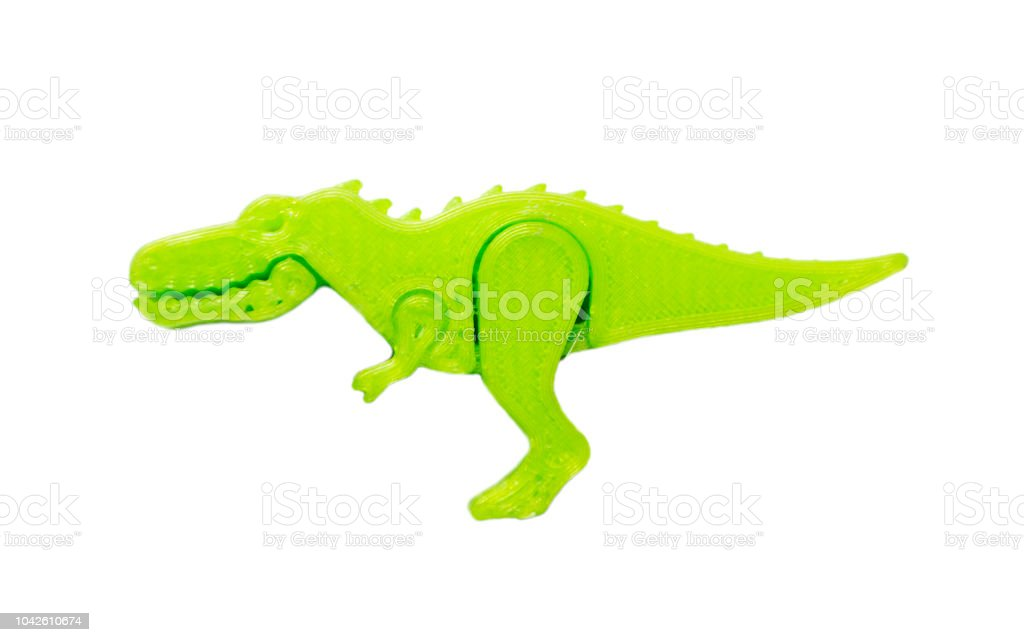 Bright light green object in shape of dinosaur toy printed on 3d printer stock photo