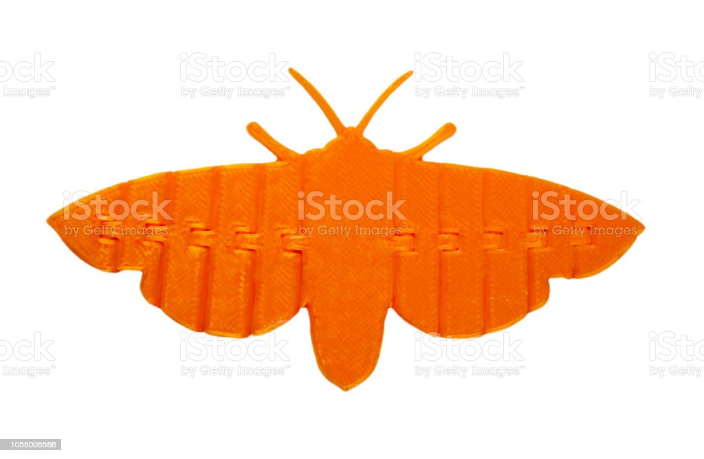 Bright light orange object in shape of butterfly toy printed on 3d printer stock photo