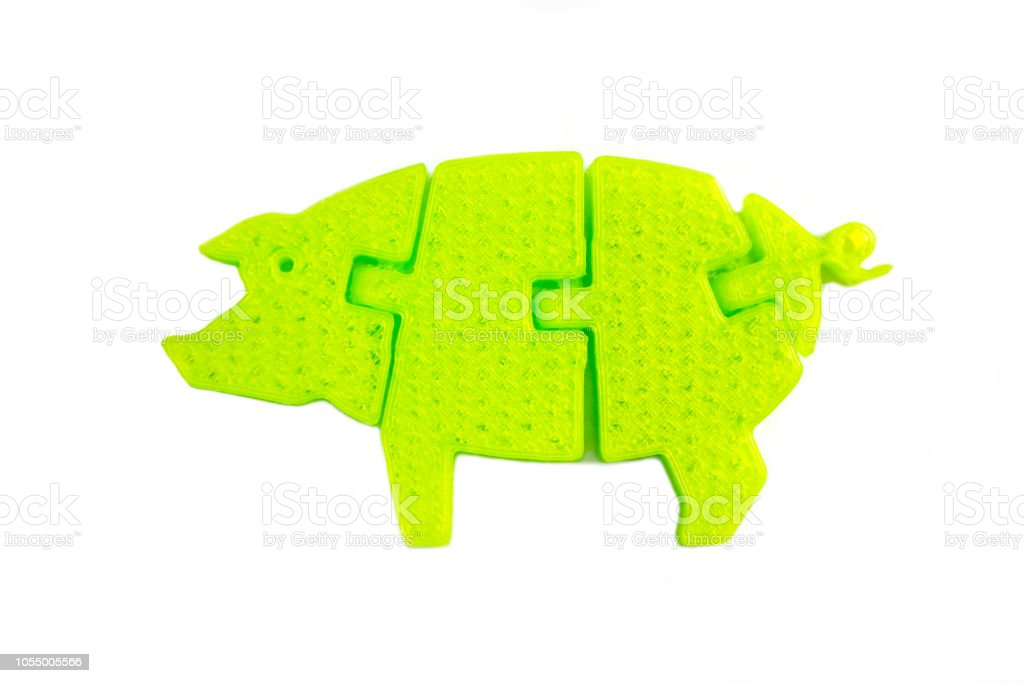 Bright light yellow object in shape of pig toy printed on 3d printer stock photo