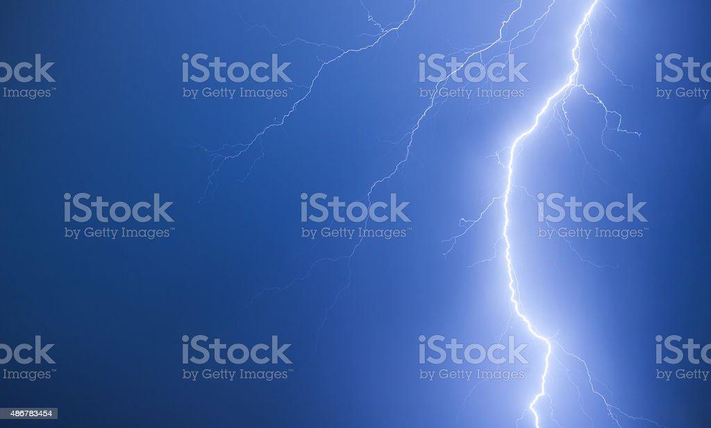 Bright lightning on a dark blue night sky stock photo