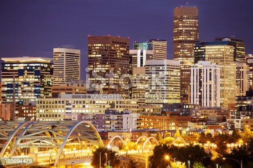 istock Bright lights in Denver's skyline at night 165694479