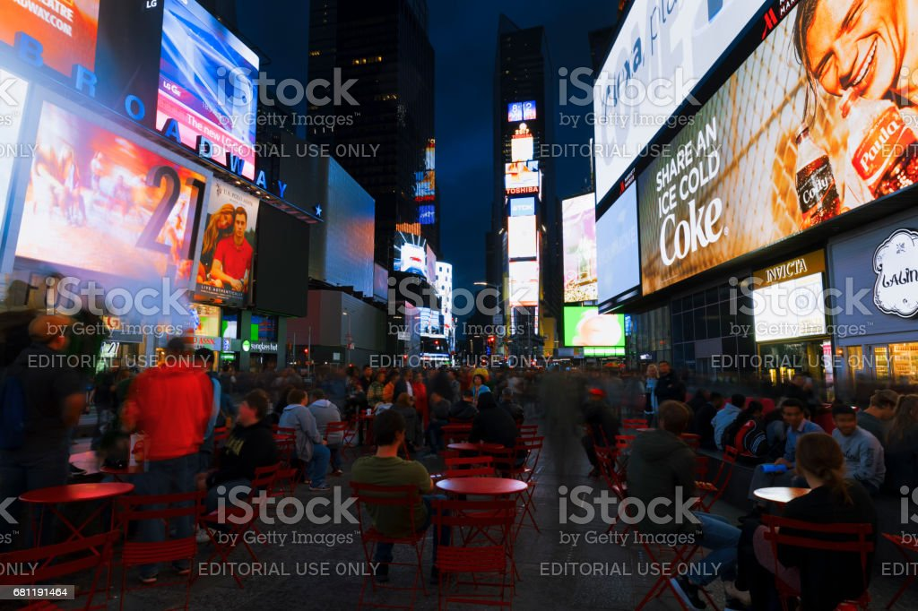 Bright lights of New York City Times Square at night. stock photo