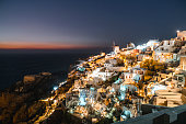 istock Bright lights of Oia town shining in the dark - Santorini 1281543554