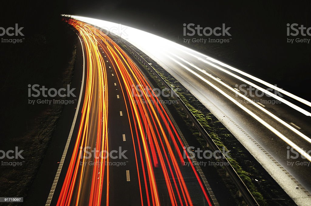 Bright lights of the traffic at night time royalty-free stock photo